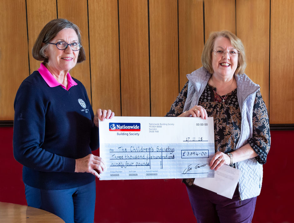 Mary Gange handing over cheque to Gill Ford-Pier